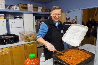 volunteers cooking up chili